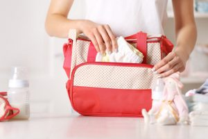 woman packing diaper bag