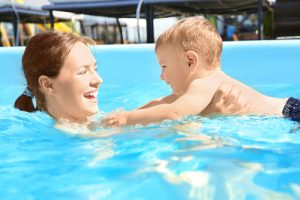 child swimming with mom