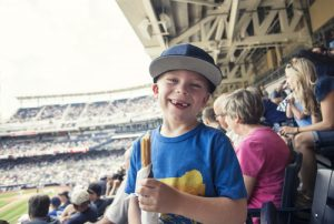 child at baseball game