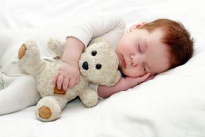 child holding bear