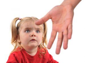 Child hesitating to take hand