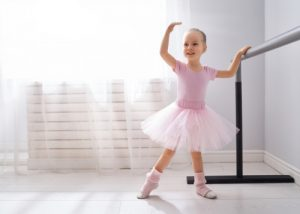 Little girl at ballet class