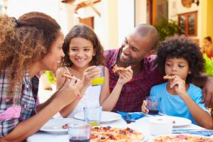 family eating at restaurant