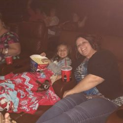 enjoying popcorn at the movies