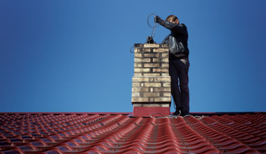 Chimney Sweep Performing Cleaning