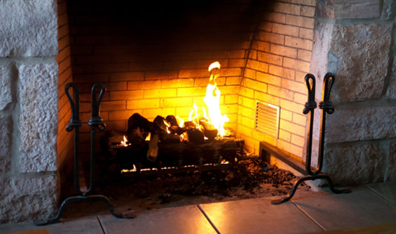 Fire in Stone and Brick Fireplace