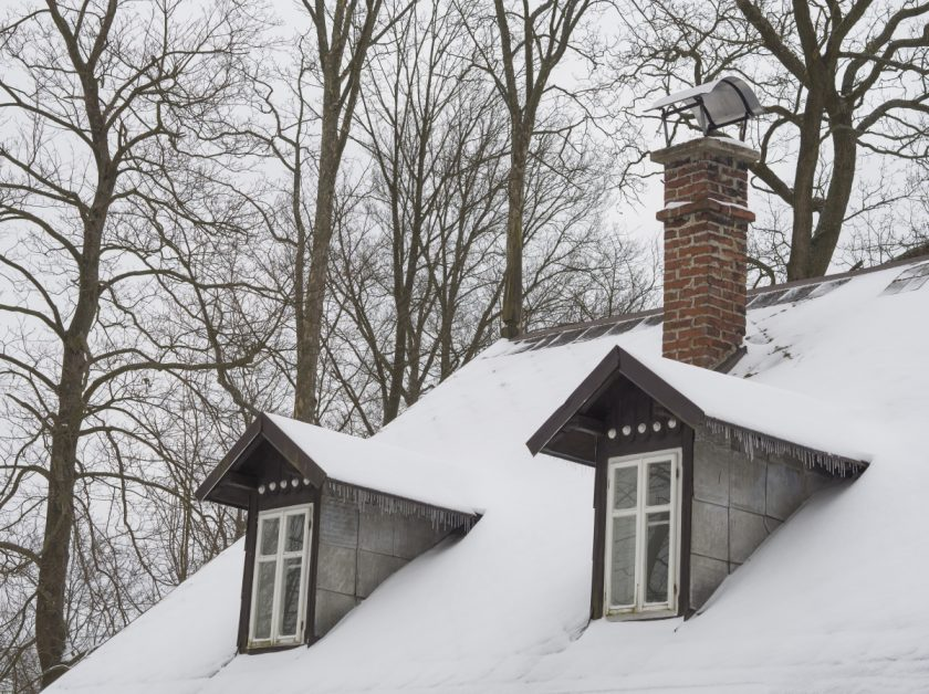 Chimney Atop a Snow-Covered Roof