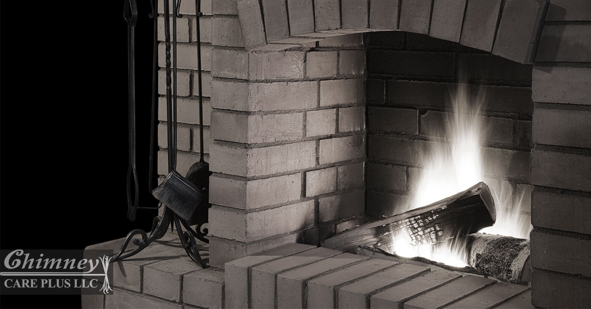Fireplace With Logs on Fire