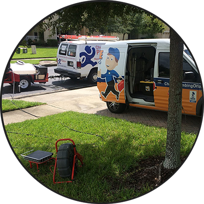 Image of two Choice Plumbing vans outside of a home