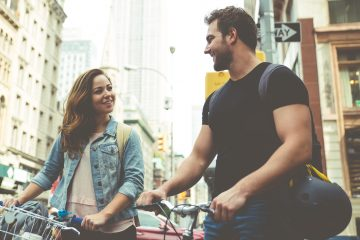 man and woman with bikes