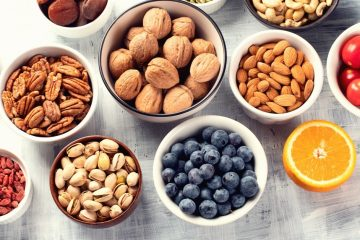 an assortment of healthy foods, such as fruits and nuts