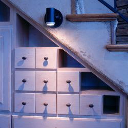 Unique Shelving Under the Stairs of Custom Home - Classic Custom Builders