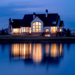 Exterior Night Shot of Luxury Waterfront Custom Home - Classic Custom Builders