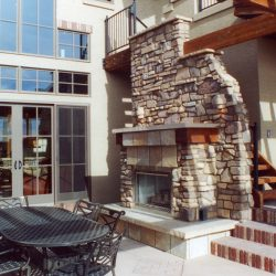 Luxury Back Patio with Table and Fireplace - Classic Custom Builders