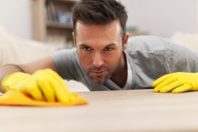 Man Cleaning Wood Surface