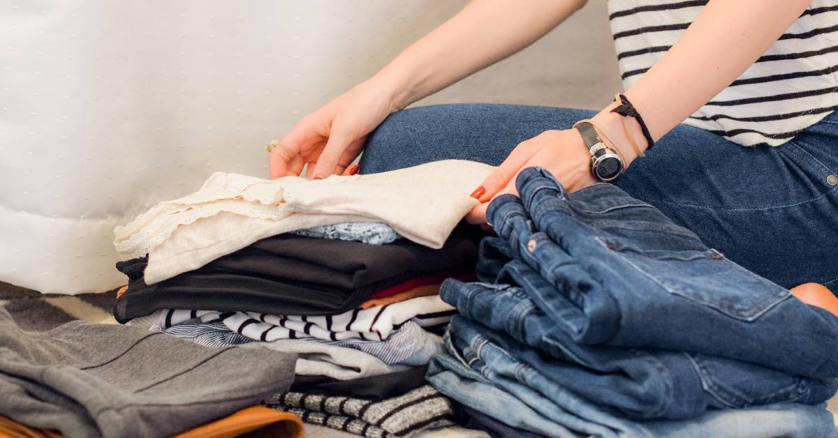 image of a person folding clothes