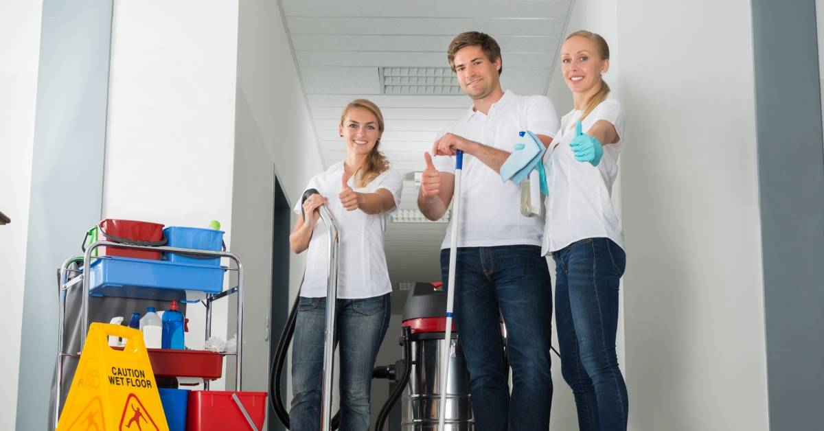 Smiling janitorial team