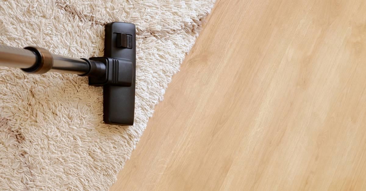Vacuuming an area rug