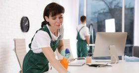 Professional janitorial team cleaning an office space