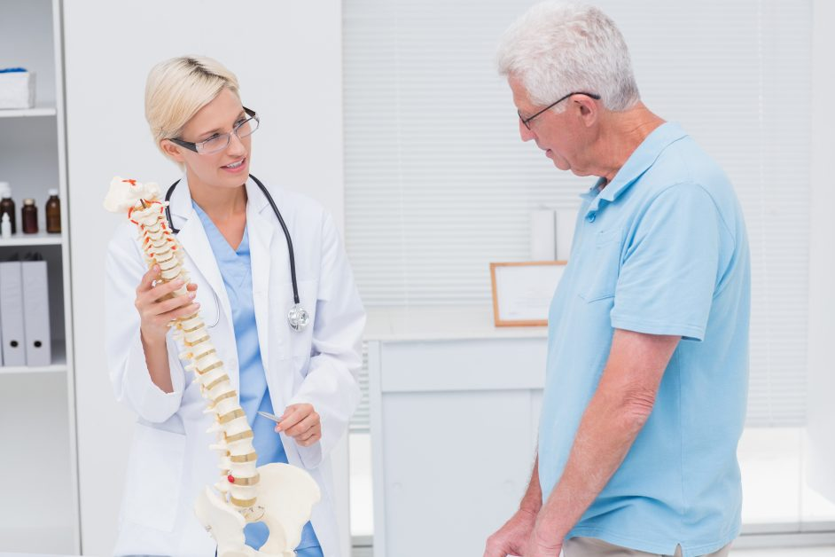 Doctor explaining spine to patient