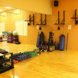 workout room with free weights and punching bag