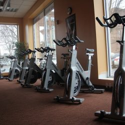 Exercise bikes in a row