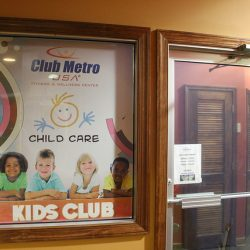 Club Metro USA child care kids' club sign near entrance