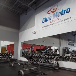 Club Metro USA free weights in front of mirror