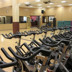 Club Metro USA stationary bikes in room with mirrors