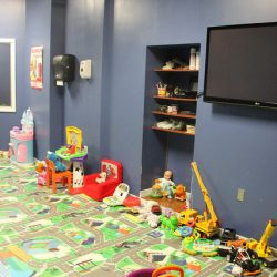 Club Metro USA kids' club room with toys and TV