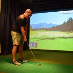 Club Metro USA man using golf simulator