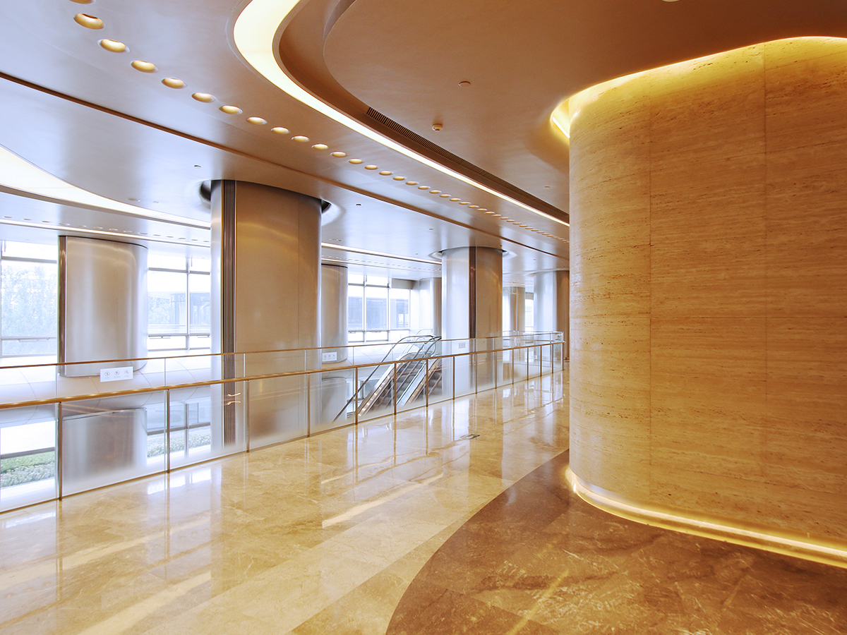 A fancy, well lit lobby of a nice office building.