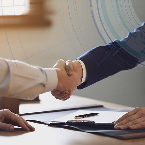 A realtor and a building owner shaking hands after a successful sale