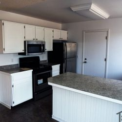 White cabinets in outdated kitchen before remodel