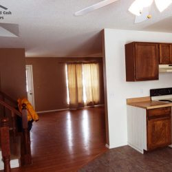 Kitchen and living room portion of a piece of unwanted property that sold for all cash
