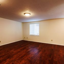 Dark red hardwood flooring in a remodeled living room