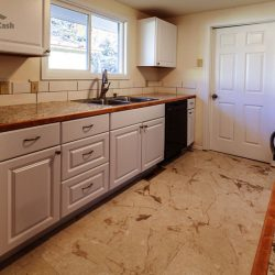 Kitchen in need of refurbishing after all cash purchase