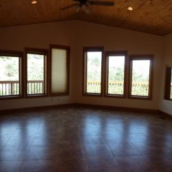 Open floor plan with huge windows and rustic aesthetic that was purchased by a Northern Colorado home buyers company