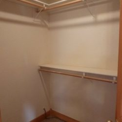 Walk-in closet within an unwanted property that sold for all cash to an all cahs home buyer in Fort Collins