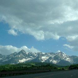 Roadside view of clouds and the Rocky Mountains - Colorado Pest Management