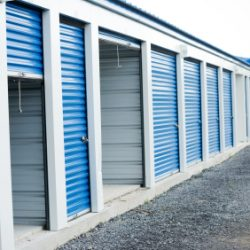 A series of storage units with blue doors - Colorado Pest Management