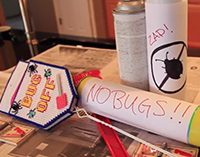 A flyswatter and cans of bug spray at Colorado Pest Management