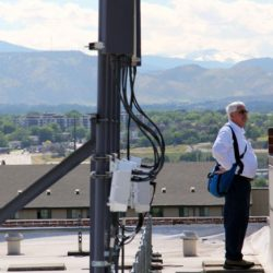 A Colorado Pest Management technician looking at the view from a rooftop