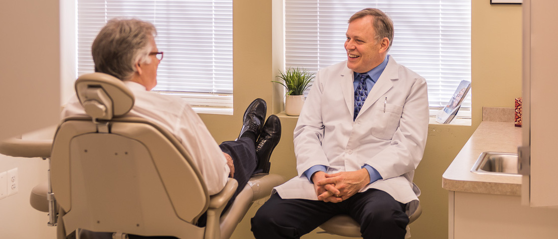 Sterling VA Dentist Thomas Bursich Consulting Patient at Sterling Dental Center