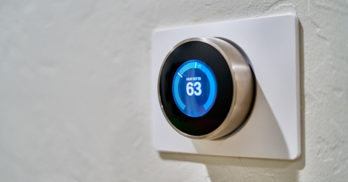 Image of a Nest thermostat displaying 63 degrees.