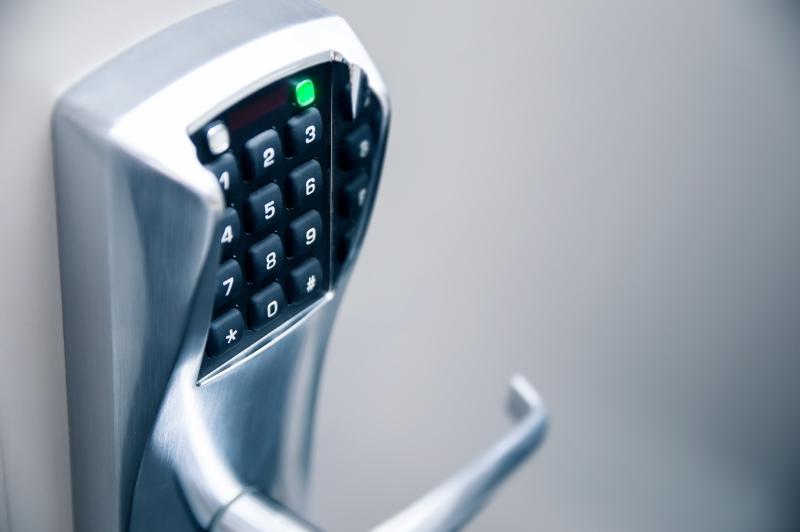 A keypad lock on a white door.