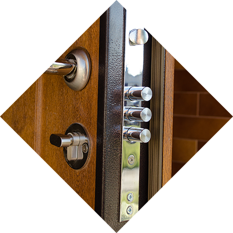A triangular image of a very secure door with multiple deadbolts.