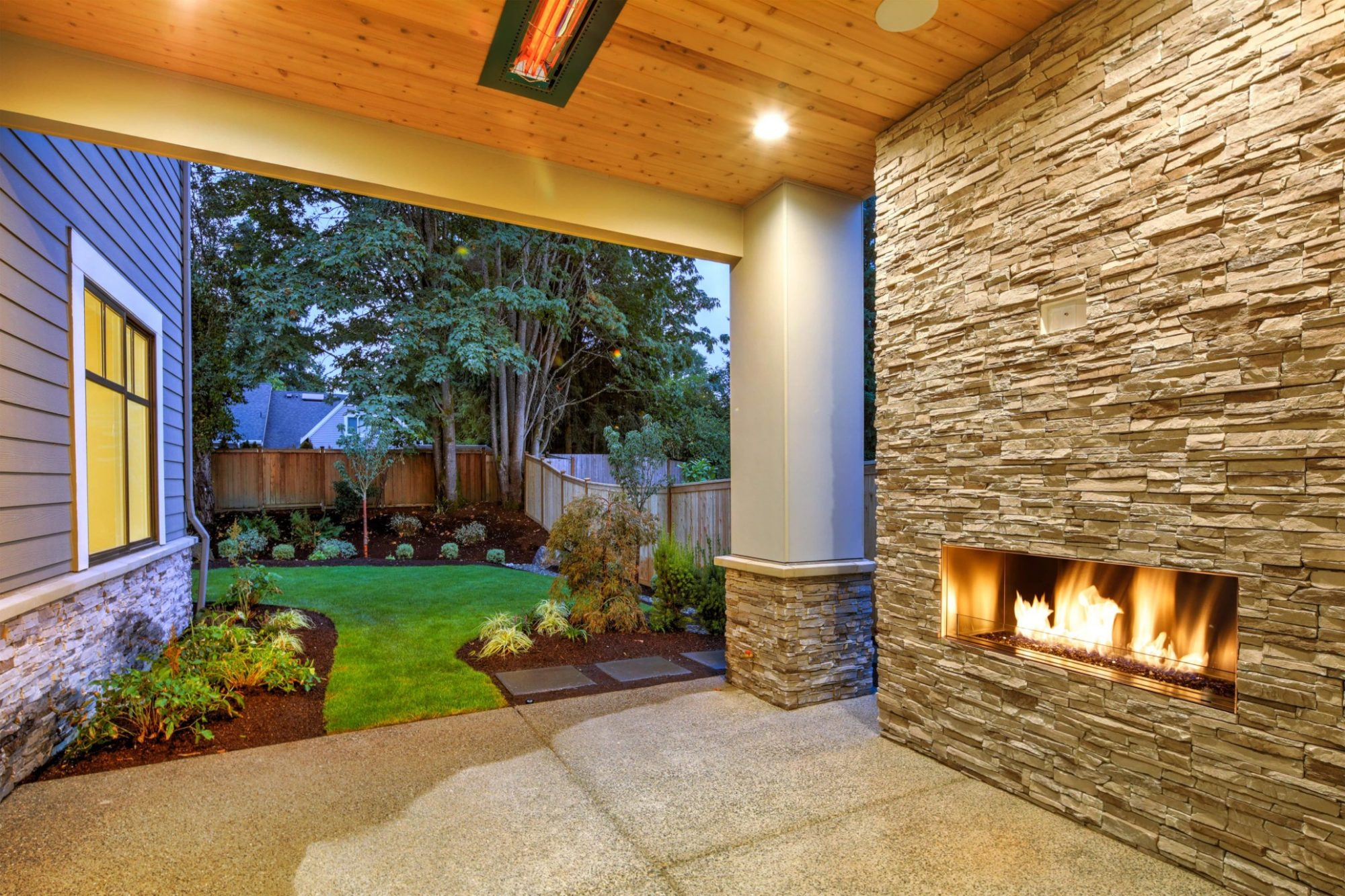 covered patio fireplace by compass outdoor design in dfw