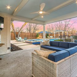 Simple outdoor living space in Dallas near a swimming pool