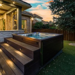 Hot tub outside an outdoor living space in Dallas, TX